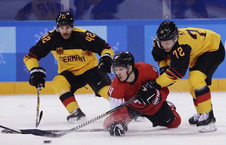 Немецкие хоккеисты победили швейцарцев в овертайме и сыграют в 1/4 финала ОИ со шведами