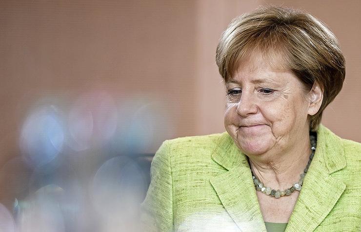 Меркель поведала , когда снимет санкций с РФ